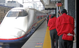 Japanese  train cleaners bow as the Tohoku ShInkansen pulls into Tokyo on April 20, 2011. Photo by Tom Sawyer/ENR