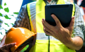 construction worker with a tablet