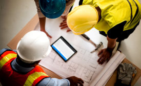 construction workers and blueprints