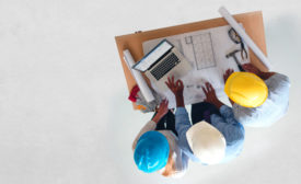 Overhead view of construction workers at a desk