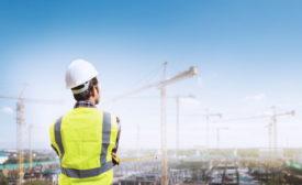 engineer looking at cranes