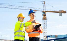 construction engineers near a crane