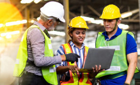 construction engineers looking at a laptop