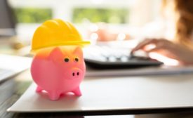 piggy bank with a construction hat