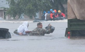 National Guardsman rescues man in floodwater