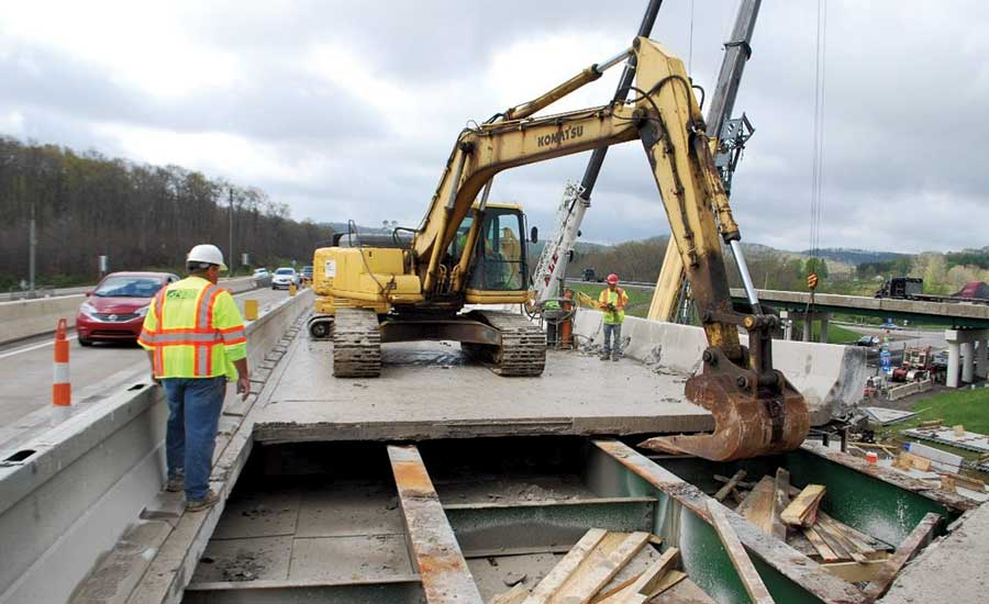 Crew demolishes a bridge deck