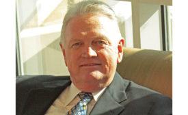Board chairman Randy Okland