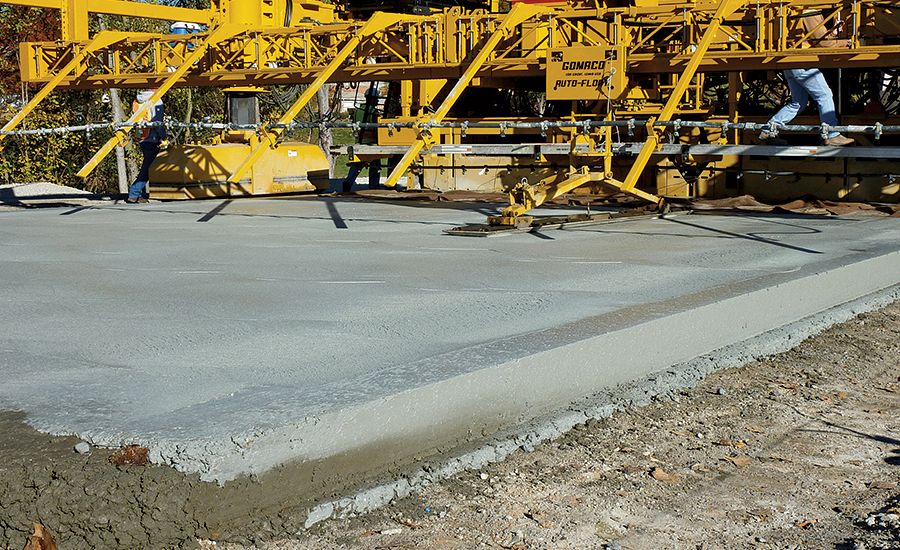 Crews pave a road segment in St. Louis, Mo.