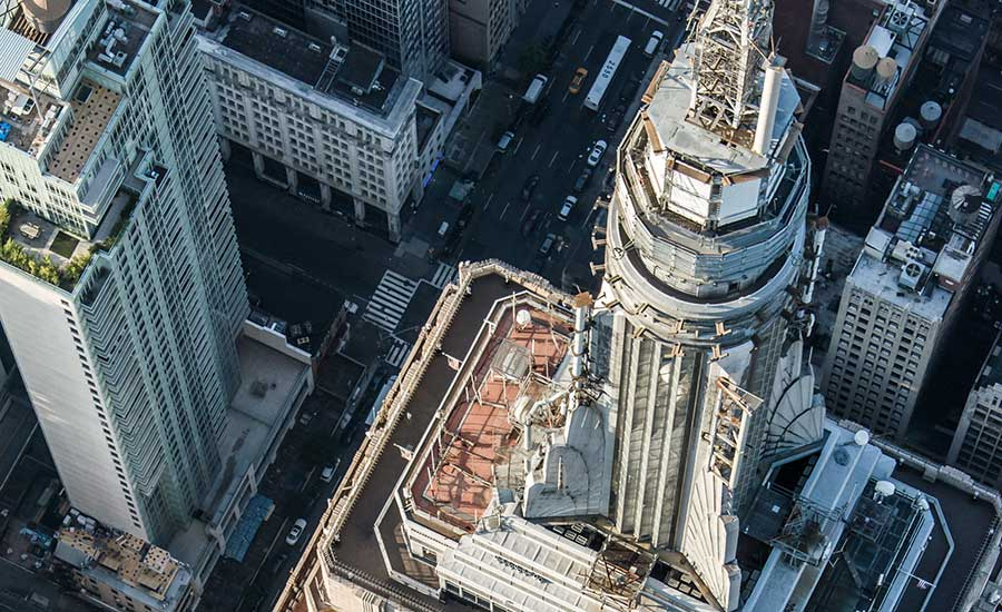 how to add 39 tons of steel to the top of the empire state building