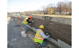 replacing stones in Union Turnpike retaining wall