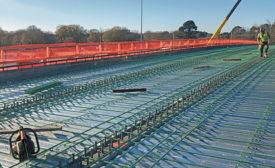workers preparing a bridge with rebar