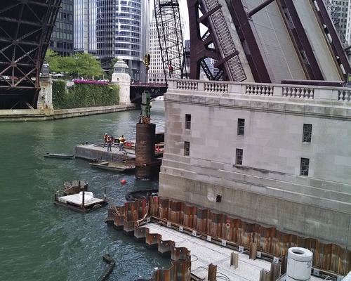 Crews Create Land Over Water for New Riverwalk