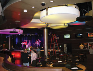 """Sevens"" is the new $2.15-million sports bar and entertainment venue at the Casino Queen in East St. Louis, Ill. Kaiser Electric recently completed wiring for the club's extensive array of lighting, stage, audiovisual, and bar equipment."