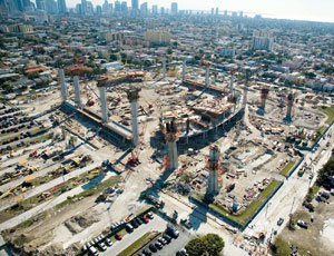 This aerial photo of the project shows the super-columns taking shape.