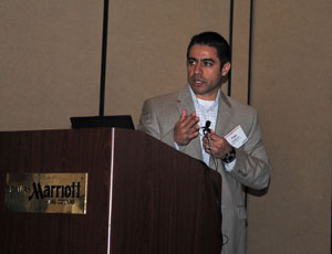 Fred Cardenas, virtual design and construction manager for Austin Commercial, address the conference in Las Colinas.