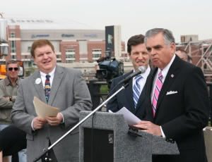 U.S. Secretary of Transportation Ray LaHood addresses a large gathering at the groundbreaking for the new Mississippi River Bridge in St. Louis. Also pictured is Missouri Department of Transportation Secretary Pete Rahn, far left.