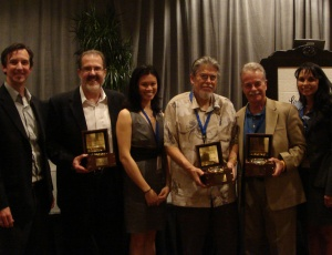 At the awards ceremony are, from left, Geoff Graney (KTGY), Ken Ryan (KTGY), Jamie Lai (Anaheim Transit Manager), Bob Hernandez (Anaheim City Councilman), Will Kempton (Chief Executive Officer of OCTA) and Laura Muna-Landa (Arellano-Associates)