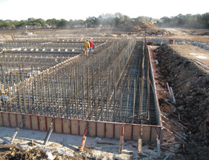 Pepper-Lawson is building the Brushy Creek Water Treatment Plant. Due to the size of the initial basin, crews poured segments of the first basin, then returned to pour the walls atop the mat.