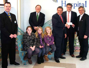 East Rutherford, New Jersey-based Mc Gowan Builders, Inc. donated $15,000 to St. Joseph's Children Hospital at a ceremony that took place at the hospital's main campus in Paterson, New Jersey. Seated from left: Patrick Mc Gowan's daughters Niamh, Emma, and Sarah Mc Gowan. Standing from left: Chris Coyne, Director of Major Gifts, St. Joseph's Regional Medical Center Foundation; Timothy P. Barr, Vice President for Development, St. Joseph's Healthcare System, and Executive Director, St. Joseph's Regional Medical Center Foundation; Patrick J. Mc Gowan, President of Mc Gowan Builders; Martin C. Mc Gowan, Vice President of Mc Gowan Builders; and Michael Lamacchia, MD, Chairman of Pediatrics, St. Joseph's Children's Hospital.