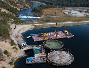 The cofferdam consists of two 16-ft-wide and 80-ft-tall steel cylinders filled with 45,000 cu yd of backfill each. (Photo courtesy of PPL Montana)