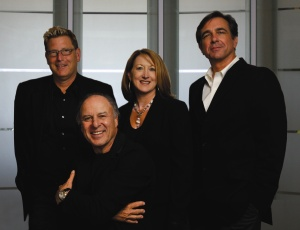Current Nadel executives, from left, Patrick Winters, Joan Frei, and Greg Palaski join founder Herb Nadel of Nadel Architects (center)