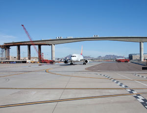 Officials think mass transit guideway at Phoenix airport may be the only one of its kind to cross through active airspace.