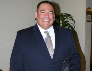 Frank Zamora accepts the 2010 CEA Most Improved Safety Program Award on behalf of Dome Construction Corp.