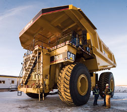 GPS-equipped open-pit haulers carry nearly 400 tons per trip.