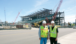 Superintendent Schnieders (left), a former craft worker, and project exec Kitchings, embrace BIM at jobsite.
