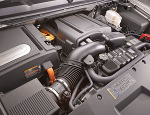 The hybrid system consists of a 6.0L V8, a two-mode transmission and a 300-Volt nickel-metal-hydride battery pack.
