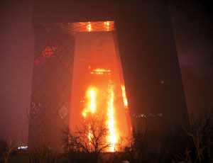 Observers speculate titanium-zinc alloy may have fueled fire on outside of tower.