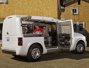 In 2010, Nissan's van may offer a built-in workstation, while Ford's compact model will become its first all-electric vehicle.
