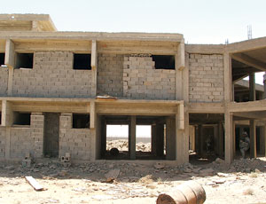 Iraqi prison job was halted, but Ministry of Defense building was completed.