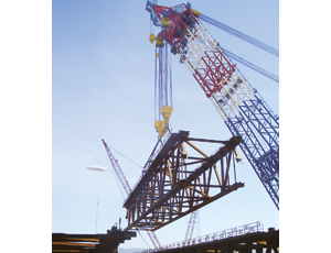 The muscular Left Coast Lifter can now begn to erect steel on the New Bay Bridge.
