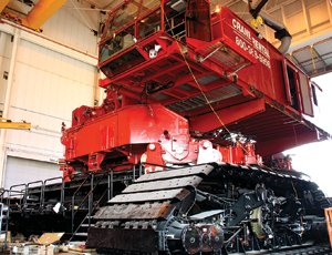 The giant crane's lowerworks are powered by two 600-hp Cummins diesels and stand firm on four trunnion-mounted tracks. Tellock says Manitiwoc may apply its patented designs to other rigs.