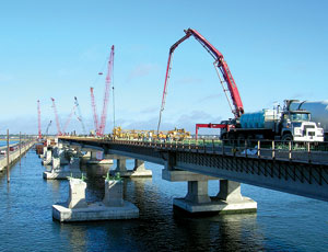 Causeway bridges are being replaced to handle heavy shore traffic.