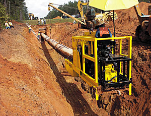 Pipeline installation: Boring Machine Works In the Trench