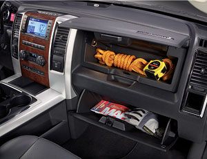 Trucks have twin glove boxes, a big center console and floor cubbies.