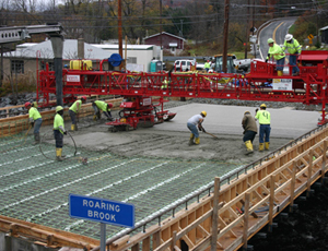 Finishing Concrete Bridge Decks: All-Hydraulic Rig