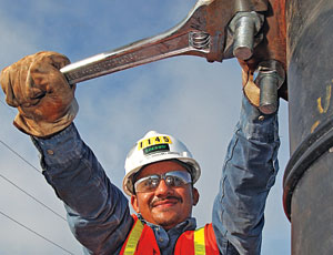 "Manuel Anselmo-Arroyo tightens a nut on a powerplant job at Cane Island, Fla. ""These people work really hard, day in and out,"" says Hollimon, who flew in for a site visit to capture this shot. ""I am blessed to get to do it,"" she says of her work."