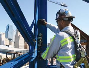 Hague inspects bolts and pins on a J.E. Dunn tower crane working in downtown Kansas