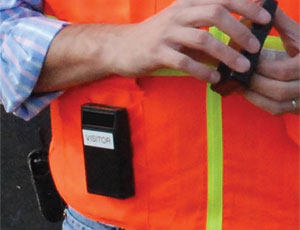 Warning device worn by a worker (below) approaching a danger zone emits a signal picked up by a device in the equipment's cab (above).