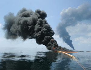Controlled burn removes oil from the Gulf of Mexico surface in May.