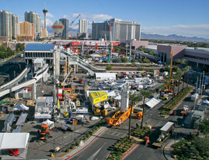 Caterpillar's new truck model (far right) was unveiled at the opening of the 2011 CONEXPO in Las Vegas, where construction industry attendees expressed hope that the recession is fading.