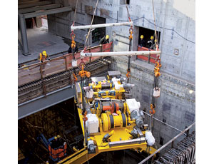 Equipment is lifted into a vitrification plant at a DOE nuclear waste site.